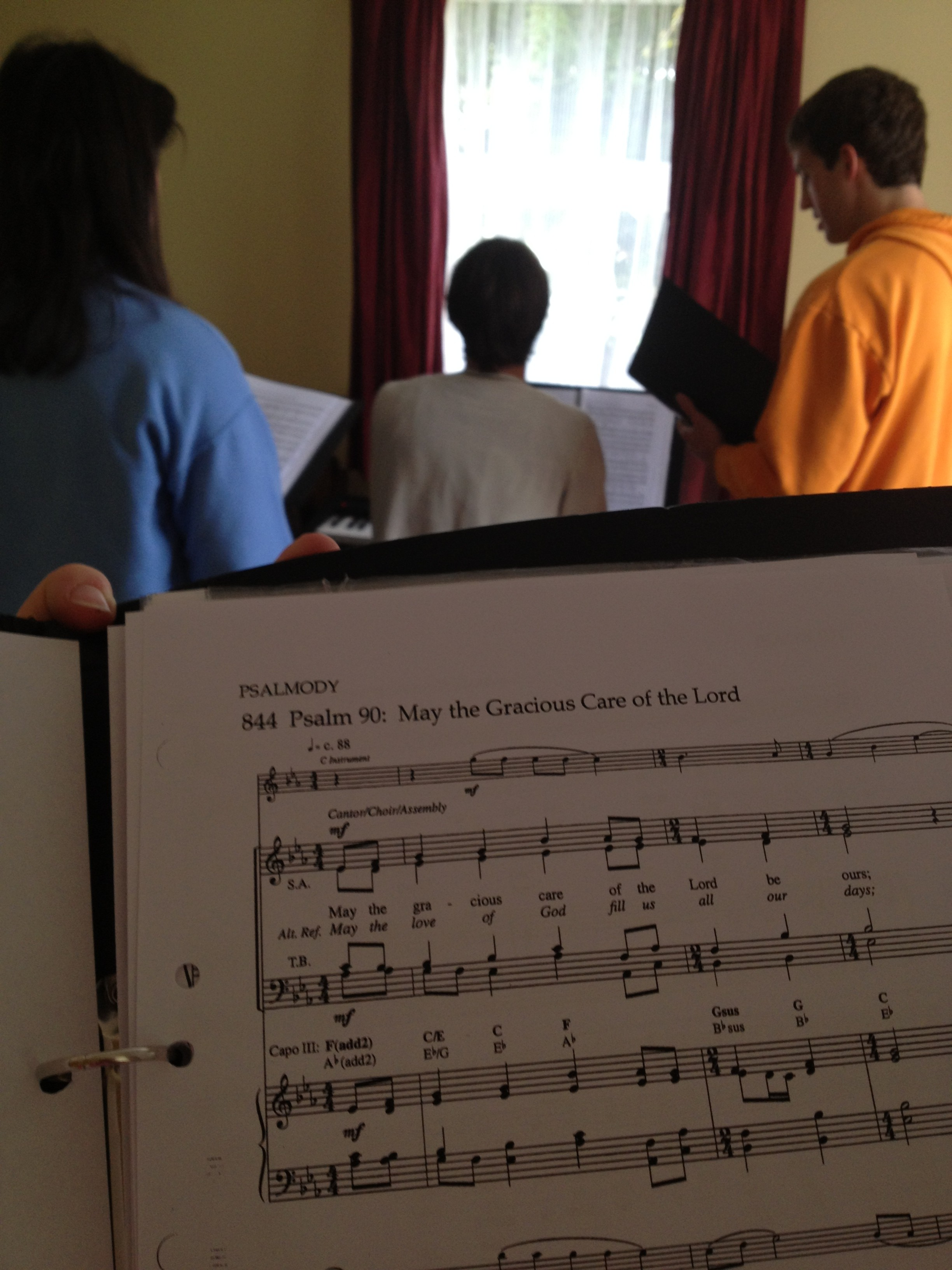 It's really not uncommon for us to gather around the piano and practice music.  (Take a guess who's music we're working on here!)